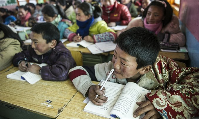 Local children study Tibetan at a bilingual primary school in Aba, Sichuan Province on March 4. Photo: Li Hao/GT