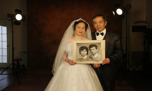 Romantic Mr Wang, 66, and his wife, 63, pose for a new wedding photo 32 years after their original wedding photos were taken at the Renmin Photo Studio. Photo: Cai Xianmin/GT