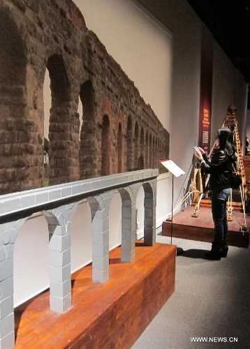 A visitor watchs the ancient Rome-related exhibits during an exhibition at Hong Kong Science Museum in south China's Hong Kong, Jan. 23, 2013. Exhibition