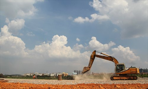 An excavator works on July 19 at the site in Changsha, Hunan Province where an ambitious Sky City, aiming to be the world's tallest tower, is to break ground. Photo: IC