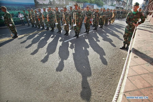 Cambodian troops march in front of the Royal Palace in preparation for the funeral of late King Father Norodom Sihanouk in Phnom Penh, Cambodia, Jan. 19, 2013. Sihanouk died of illness at the age of 90 in Beijing on Oct. 15, 2012. His body will be moved to a custom-built crematorium at the Meru field next to the Royal Palace on Feb. 1 and kept it for another three days at the site before it is cremated on Feb. 4. (Xinhua/Sovannara)