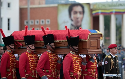 The body of late Venezuelan President Hugo Chavez is carried from the Military Academy to the Mountain Barracks, in the city of Caracas, capital of Venezuela, on March 15, 2013. Venezuelans honored late President Hugo Chavez, before his remains were transfered to the Mountain Barracks, where he will rest inside a glass case. Venezuelan President died on March 5, after struggling with cancer for two years. (Xinhua/AVN)
