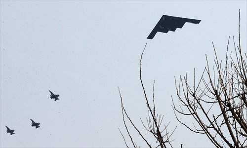 A US B-2 stealth bomber (right) flies over a US air base in Pyeongtaek, south of Seoul. Two nuclear-capable US B-2 stealth bombers flew what the US military described as