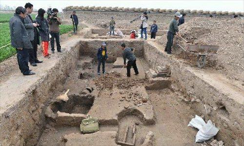 Archeological workers work at at a newly discovered ancient workshop site in Zibo, east China's Shandong Province, April 23, 2013. A bronze mirror workshop, dating from some 2,000 years ago in China's Han Dynasty (202 B.C.-220 A.D.), was discovered in Zibo and believed to be the first of its kind discovered in China. Photo: Xinhua