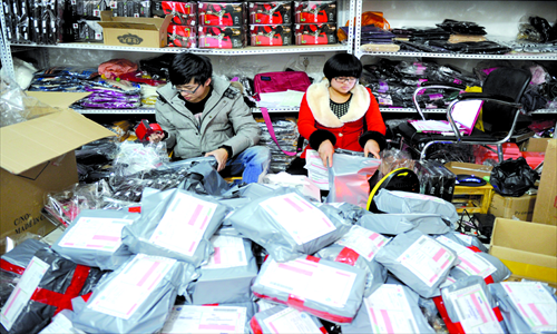 Students package their products to be delivered to customers. Photo: CFP