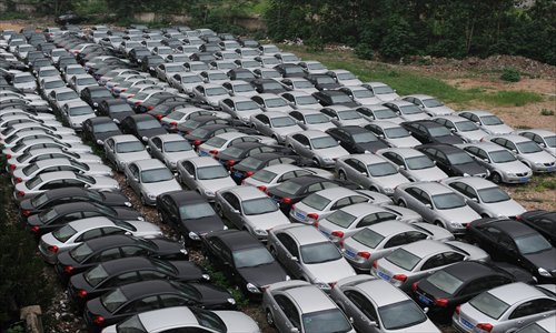 For the past two weeks, 200-plus Buicks have been parked at an abandoned 0.5 hectare-demolition site, in Jianghan district, Wuhan, Hubei Province. No one knows who owns the cars, but residents fear they are a hazard because they might catch fire under the hot sun. Photo: CFP