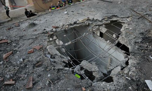 A house is damaged by mortar rocket fired from the Gaza Strip, in Ofakim, South Israel, on Nov.19, 2012. Rocket fire against Israel resumed Monday morning.