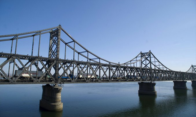 The China-North Korea Friendship Bridge crosses the Yalu River, linking Dandong, Northeast China's Liaoning Province, and North Korea's second largest city, Sinuiju. Nearly 80 percent of all bilateral trade goes through Dandong. Photo: CFP
