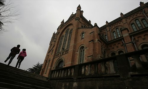 Visitors walk in front of the Sheshan church which is under renovation on March 13 in Shanghai. Photo: IC