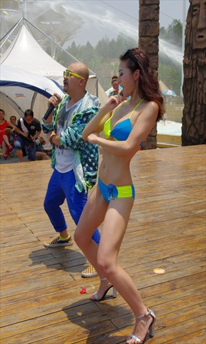 A contestant shares a hot dance with a judge at a Miss Bikini Global event in Wuhan, Hubei Province on July 13. Photo: CFP