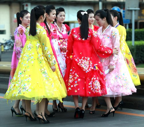 Newly hired North Korean hostesses, working at a North Korean restaurant, take an afternoon off to see their new neighborhood in Beijing. Photo: CFP