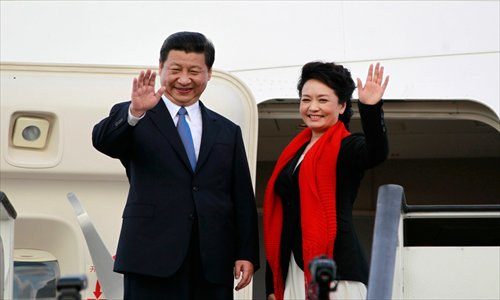 Chinese President Xi Jinping and wife Peng Liyuan bid Tanzania farewell before boarding a plane to South Africa for the next leg of Xi's state visits on March 25. Photo: ifeng.com