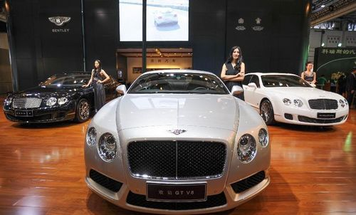 Models present cars of Bentley during the 15th Chengdu Motor Show (CDMS) in Chengdu city, Southwest China's Sichuan Province, August 31, 2012. The CDMS opens to the public from August 31 to September 9, with the participation of a total of 420 exhibitors from home and abroad. Photo: Xinhua