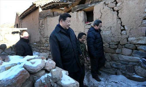 Xi Jinping (L, front), general secretary of the Communist Party of China (CPC) Central Committee and chairman of the CPC Central Military Commission, visits the family of Tang Zongxiu (C, front), an impoverished villager in the Luotuowan Village of Longquanguan Township, Fuping County, north China's Hebei Province, Dec. 30, 2012. Xi made a tour to impoverished villages in Fuping County from Dec. 29 to 30, 2012.  Photo: Xinhua