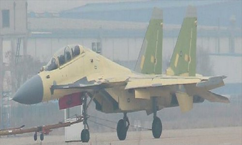 "A two-seat variant of the J-15 carrier-based fighter is spotted Saturday at the runway of the Shenyang Aircraft Corporation (SAC), Liaoning Province, two days after the maiden flight of SAC's stealth fighter dubbed as ""J-31."""