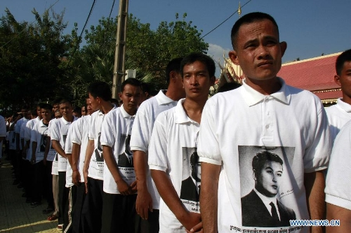 Former prisoners who were granted a royal pardon by Cambodian King Norodom Sihamoni attend the cremation ceremony of late Cambodian King Father Norodom Sihanouk in Phnom Penh, Cambodia, Feb. 4, 2013. Cambodia began to cremate the body of the country's most revered King Father Norodom Sihanouk on Monday evening after it had been lying in state for more than three months at the capital's royal palace. (Xinhua/Sovannara)