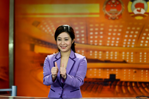Zhang Lijun, a sign language expert, interprets during the live broadcast of the First Session of the 12th Chinese People's Political Consultative Conference (CPPCC) Saturday morning in Shanghai. Photo: Cai Xianmin /GT