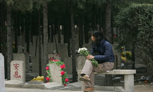 A woman sits at Babaoshan Cemetery in Shijingshan district. Photo: Li Hao/GT