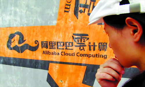 A passer-by looks at an advertisement for Alibaba Cloud Computing in Hangzhou, Zhejiang Province. Photo: CFP