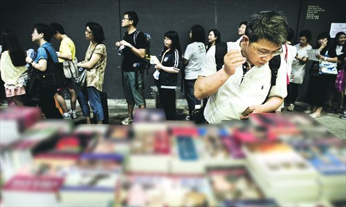 A man looks at Chinese political books at the Hong Kong Book Fair on July 18. More than 530 exhibitors from 20 countries took part in the six-day fair which drew in around 900,000 visitors. The annual event is known for shedding light on works that have been banned on the Chinese mainland. Photo: AFP