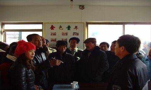 Villagers of Panguanying in Hebei Province confront the county police chief (first on the right) after the botched election. Photo: Liu linlin/GT