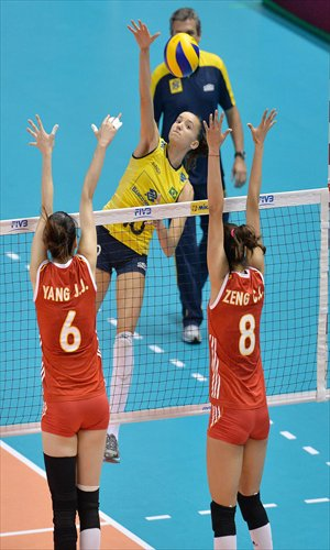 Gabriela Guimaraes (center) of Brazil spikes the ball against China during their FIVB World Grand Prix Finals match on Sunday in Sapporo Japan. Photo: CFP