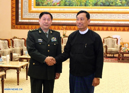 Speaker of the House of Representatives of Myanmar U Shwe Mann (R) shakes hands with visiting Deputy Chief of General Staff of the Chinese People's Liberation Army Qi Jianguo in Nay Pyi Taw, capital of Myanmar, on Jan. 20, 2013. Qi jianguo arrived here Saturday for the first China-Myanmar strategic security consultation. (Xinhua/U Aung)