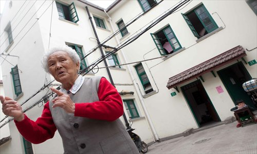 One resident looks over her old home at Caoyang New Village on Zhongshan Road North. Photos: Yang Hui/GT