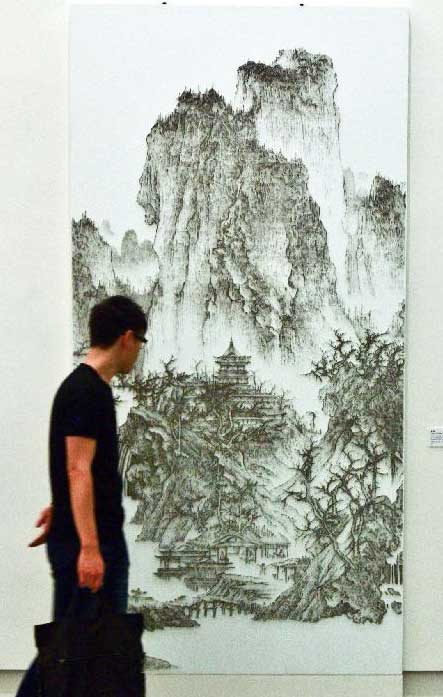 Taiwanese artist simulates ink painting with nail gun global times a visitor watches taiwanese artist chen chun haos nail drawing work buddhist temple in mountain prinsesfo Image collections