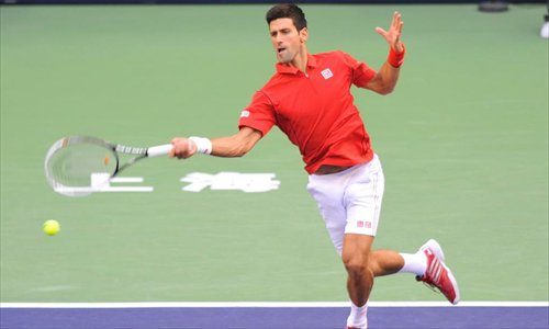 Novak Djokovic of Serbia returns to Argentine Juan Martin del Potro during the final match of the Shanghai Masters on Sunday. Photo: IC