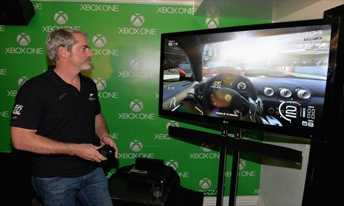 how to take a photo on xbox one