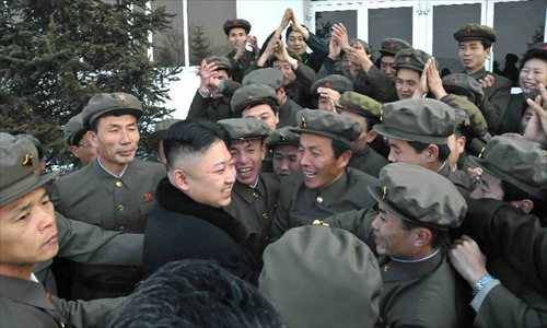 This photo provided by KCNA on Dec. 14, 2012 shows Kim Jong Un (C), top leader of the Democratic People's Republic of Korea (DPRK), celebrates with people after the successful launch of Kwangmyongsong-3 satellite at the Pyongyang General Satellite Control Command Center on Dec. 12, 2012. Kim Jong Un personally commanded Wednesday's satellite launch and observed the whole launching process, the official news agency KCNA reported earlier Friday.  Photo: Xinhua