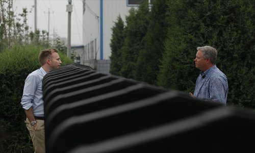 Chip Starnes, the American executive who has been held by his workers in his plant in Huairou, Beijing for the past six days, answers questions from a reporter at the front gate on Tuesday. Photo: CFP