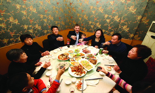 Family gatherings during Spring Festival can be a happy, toast-filled time if you know what to expect. Photo: CFP