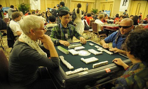 Players from around the world compete at the Third World Mahjong Championship held in Chongqing last October. Photo: CFP