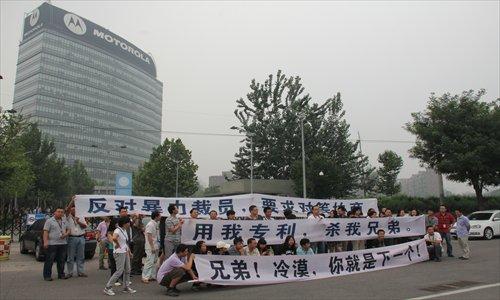 Motorola employees, holding banners saying