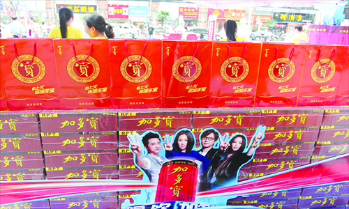 JDB products are seen with a sales promotion poster featuring the judges of popular music talent show