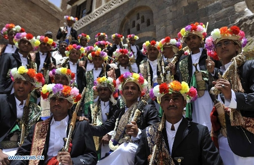 Grooms In Traditional Wedding Dresses Hold Their Swords During A Group Ceremony Sanaa