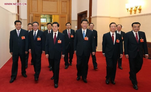 Hu Jintao, Xi Jinping, Wu Bangguo, Wen Jiabao, Jia Qinglin, Li Keqiang, Zhang Dejiang, Yu Zhengsheng, Liu Yunshan, Wang Qishan and Zhang Gaoli walk to the venue for the opening meeting of the first session of the 12th National People's Congress (NPC) at the Great Hall of the People in Beijing, capital of China, March 5, 2013. The first session of the 12th NPC opened in Beijing on March 5. (Xinhua/Lan Hongguang)Special Report: NPC, CPPCC Annual Sessions 2013