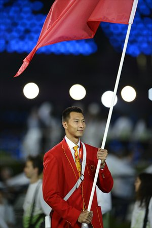 Yi Jianlian, basketball player, carries the flag for China during the opening ceremony of 2012 London Olympic Games. Photo: AFP