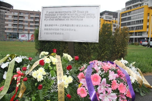 Photo taken on May 7, 2013 shows a monument to commemorate three Chinese journalists killed in the U.S.-led NATO bombing of the Chinese embassy in Belgrade. Shao Yunhuan of Xinhua News Agency along with Xu Xinghu and his wife Zhu Ying from the Beijing-based Guangming Daily newspaper were killed in the missile attack which inflicted serious damage to the embassy buildings on the evening of May 7, 1999. (Xinhua/Wang Hui)