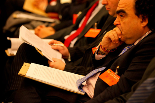 Foreign consulars in Shanghai review the English version of report provided at the conference on Saturday. Photo: Cai Xianmin/GT