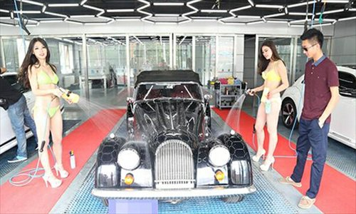 Bikini Car Wash Makes Splash Among Beijing S Luxury Car Owners
