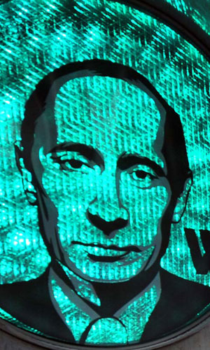 A green traffic light illuminates a transparent image of Russian Prime Minister Vladimir Putin, which was apparently stuck to the device by the Russian strongman's supporters in central Moscow, February 13, 2012. Photo:ImagineChina
