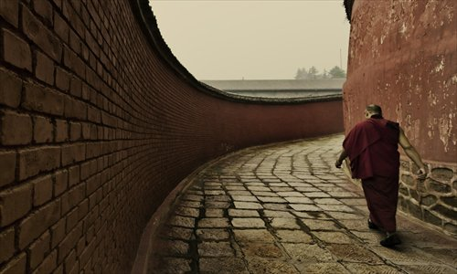 A monk walks around a temple on Wutai Mountain in Shanxi Province on September 22, 2011. Photo: IC