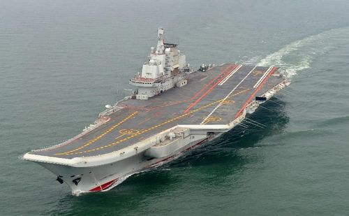 Photo taken in May 2012 shows a Chinese aircraft carrier cruising for a test on the sea. China's first aircraft carrier was delivered and commissioned to the Navy of the Chinese People's Liberation Army on September 25, 2012. The carrier, with the name