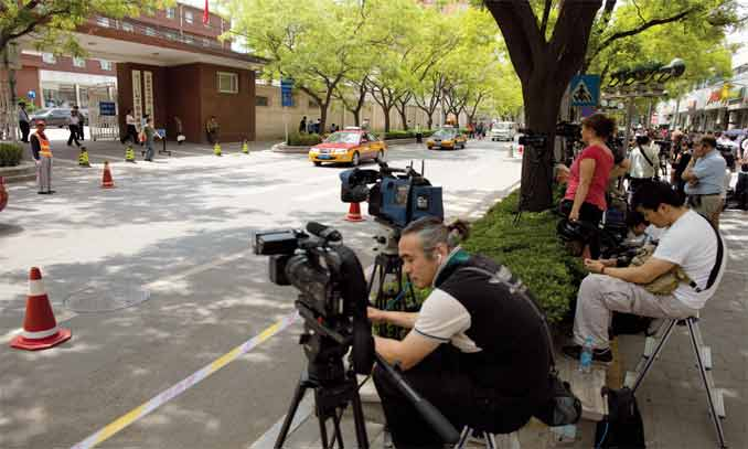 Members of the media gather inside a police cordon outside the Chaoyang Hospital in Beijing where Chinese activist Chen Guangcheng was staying on May 3. Chen appealed to US officials to help get him out of China. Photo: AFP