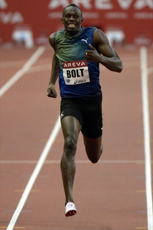 Jamaica's Usain Bolt competes to win the men's 200 meters at the Paris Diamond League on Saturday. Photo: AFP