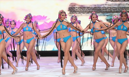 A series of photos depicting bikini-clad beauties in a sort of Peking Opera performance has spread widely on the Internet recently, arousing much criticism. Some Web users applauded the shots as a great feat of East meets West, while others balked at such an idea, pointing out that the babes clearly had no opera training. This photo was taken during the 36th Miss Bikini International competition in August 2011. Photo: CFP