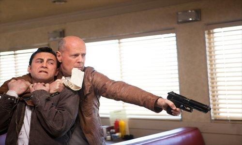 Joseph Gordon-Levitt (left) stars with Bruce Willis in Looper. Photo: CFP